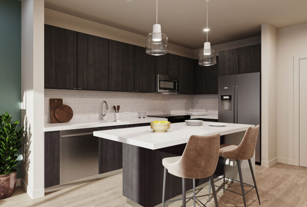 Kitchen with island and bar seating, designer lighting, stainless steel appliances, and quartz countertops